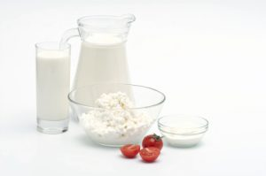 healthy breakfast: kefir, cottage cheese and tomato cherry on white background